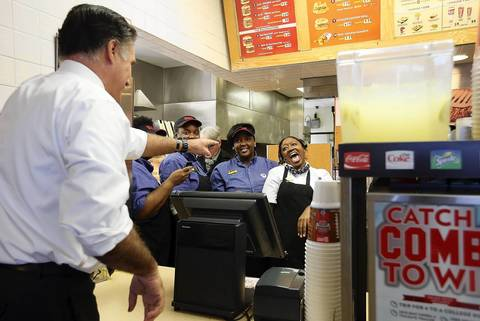 Republican presidential candidate Mitt Romney jokes with staff members at a Wendy's restaurant in Richmond Heights, Ohio.