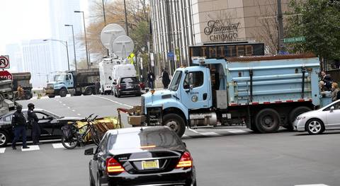 With the help of city snowplows Chicago Police secure the outside of the Fairmont Hotel in Chicago where President Barack Obama at an appearance.