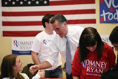 Republican presidential candidate Mitt Romney greets workers at a GOP Victory Center in Richmond Heights, Ohio.