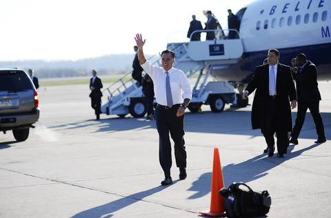 Republican presidential candidate Mitt Romney waves to supporters awaiting his arrival at Pittsburgh international airport in Coraopolis, Pennsylvania. Romney made last-minute appeals for votes on Election Day.