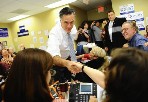 Republican presidential candidate Mitt Romney greets volunteers at a campaign call center in Green Tree, Pennsylvania.