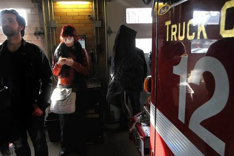 Mandy Sproul checks her phone while waiting in line to vote at a fire station at 2322 W. Foster Ave in Chicago.