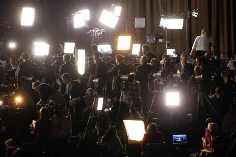 Light panels for television reporters illuminate the main media riser at President Barack Obama's election night viewing party at McCormick Place in Chicago.