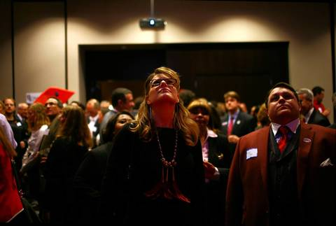 Jessica Kotches of Streator watches election night returns at the Illinois Republicans party at the Wit Hotel in Chicago.