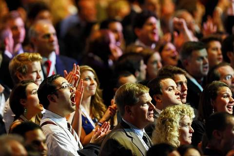 The crowd reacts to televised election results displayed at Mitt Romney's campaign election night event in the Boston Convention and Exhibition Center in Boston, Massachusetts.