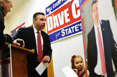 Will County State's Attorney Republican candidate Dave Carlson and daughter Alexis, 6, begin their election night at campaign headquarters with supporters shortly after polls closed, in Joliet, Ill. Carlson squared off in an election against incumbent four term Democrat Jim Glasgow.
