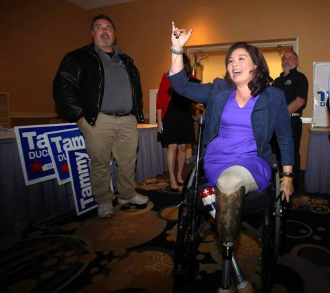 Eight Congressional District candidate Democrat Tammy Duckworth greets supporters at her election night rally at the Holiday Inn in Elk Grove Village, Ill.