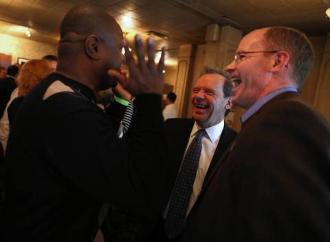 Illinois Senate President John Cullerton (center) has a laugh with Illinois State Senators Emil Jones III (left) and Don Harmon (right) at the Illinois Senate Democratic Victory Fund election night event at Harry Caray's in Chicago.