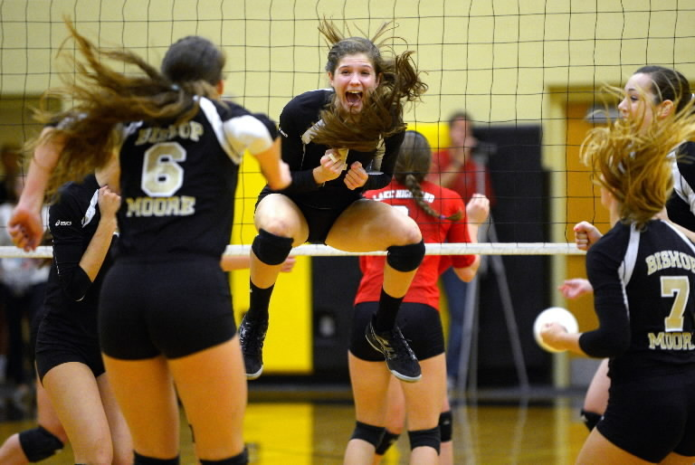 Top-ranked Bishop Moore's Gray Malias celebrates during a 3-0 (25-22, 25-18, 25-19) sweep of visiting Lake Highland in the Class 4A region semifinals on Tuesday. (Phelan M. Ebenhack/Special to the Sentinel)