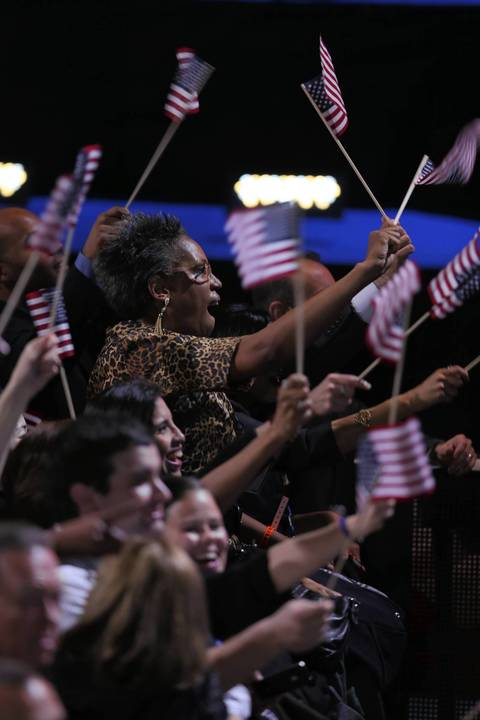 Supporters of President Barack Obama cheer as media outlets project the president to be the winner of the 2012 presidential election at McCormick Place in Chicago.