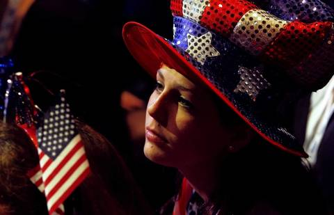 A Romney supporter watches voting returns at the election night rally for Republican presidential nominee Mitt Romney in Boston, Massachusetts.