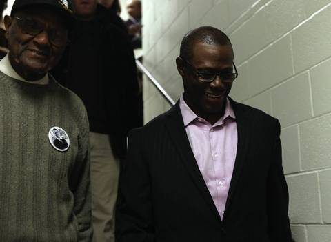 Indicted former Illinois Rep. Derrick Smith, right, who represented 10th district, and Ald. Ed Smith, left, walk down to small election night party, after the numbers favorite him in his race against Lance Tyson. arrested in March and charged with accepting a $7,000 bribe in exchange for endorsing a daycare center's state grant application.