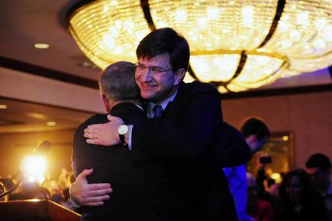 Democrat Brad Schneider enters the room to cheers after being announced the winner the 10th District Congressional race, during Schneider's election night party at the Hilton Hotel in Northbrook.