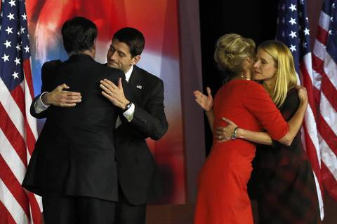 Republican presidential candidate, Mitt Romney, hugs Republican vice presidential candidate, U.S. Rep. Paul Ryan (R-WI) while his wife, Ann Romney, hugs Janna Ryan after conceding the presidency during Mitt Romney's campaign election night event at the Boston Convention and Exhibition Center.