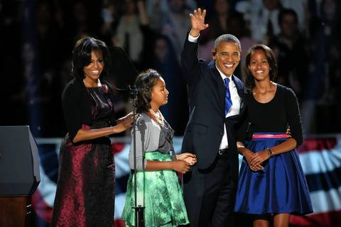 President Barack Obama, first lady Michelle Obama and daughters Malia and Sasha enter McCormick Place as the president prepares to make his victory speech in the 2012 presidential election.