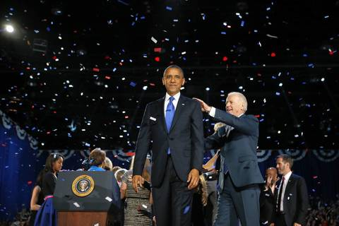 President Barack Obama gets a pat on the back from Vice-President Joe Biden following his speech during the victory rally at McCormick Place in Chicago.