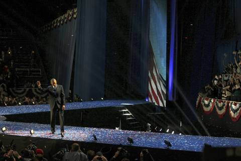 President Barack Obama waves to the crowd in McCormick Place, where he delivered his victory speech for the 2012 presidential election, in Chicago.