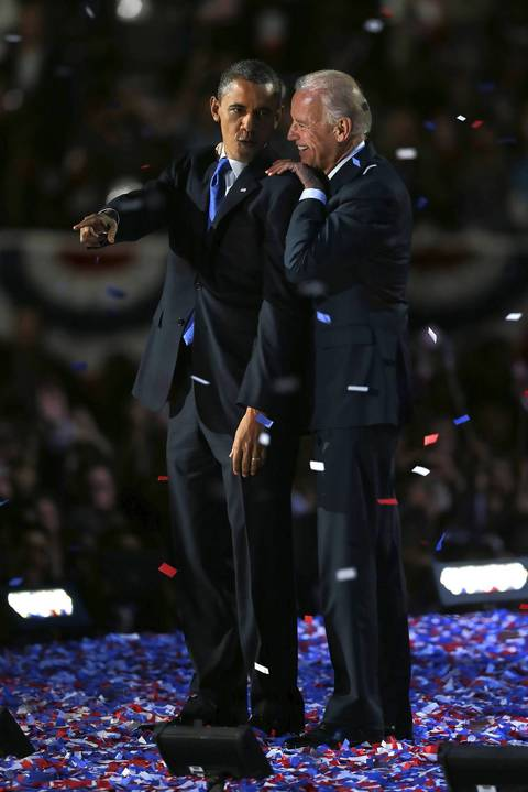 After being elected to a second term, President Barack Obama and Vice President Joe Biden share a moment at election night viewing party at McCormick Place in Chicago.