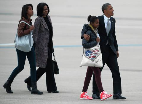 The Obama family walks to Air Force One as the leave Chicago and return to Washington, DC. The Obama's held an election night rally at McCormick Place the previous night.