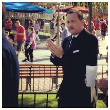 "Tom Hanks sporting a mustache in the role of Walt Disney for ""Saving Mr. Banks,"" a movie about the making of Mary Poppins."