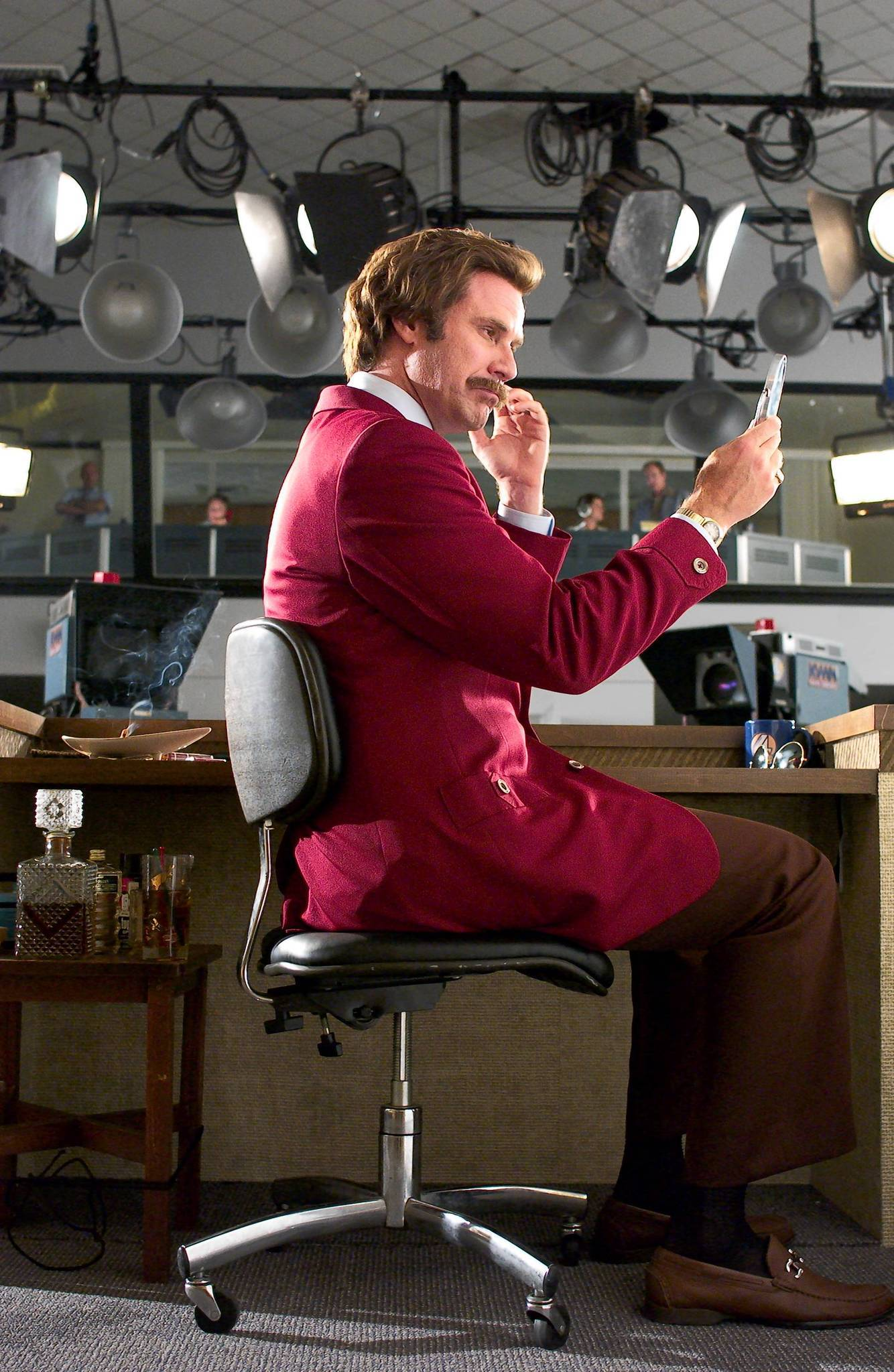 Ron Burgundy (WILL FERRELL) gives himself some last-minute touch-ups before going on air in DreamWorks Pictures comedy ANCHORMAN: THE LEGEND OF RON BURGUNDY.