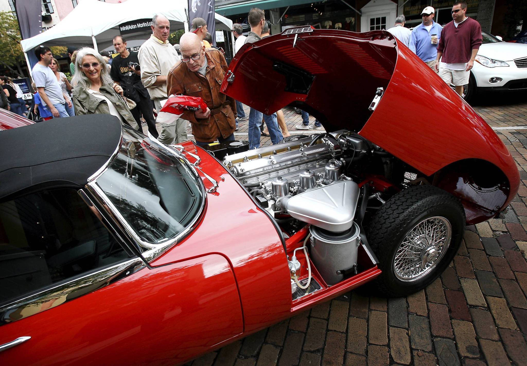 Car enthusiasts check out a 1966 Jaguar 3 Type Roadster along Park Ave during the Concours d'Elegance luxury auto show in Winter Park on November 6, 2011.
