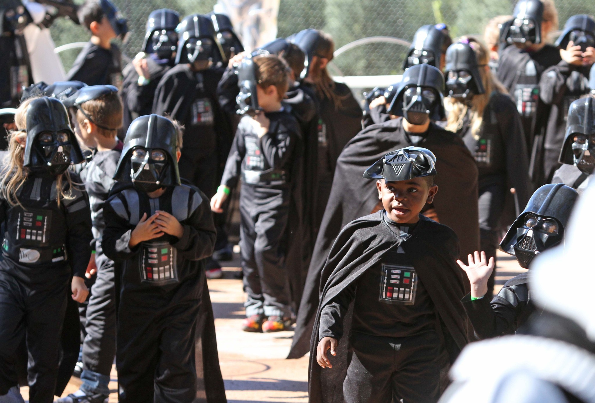 Mini-sized Darth Vaders march in during the opening of the Stars Wars Miniland display at Legoland Florida, Friday, November 9, 2012.