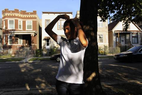 Yajaira Rivera, 13, stands on her street after school in Chicago. Coping with learning and emotional disabilities, she's trying to get back on track after months of elementary grade absences and suspensions.