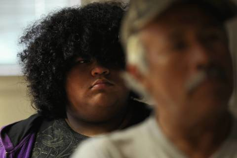"""Alejandro """"Alex"""" Frausto, 12, and his father Javier meet with LaSalle County school officials at a truancy hearing in Peru, Ill."""