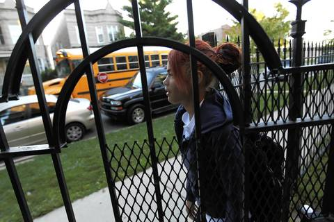 Yajaira Rivera, 13, heads to the school bus in her Humboldt Park neighborhood. The eighth-grader has missed more than a full year of school since kindergarten.
