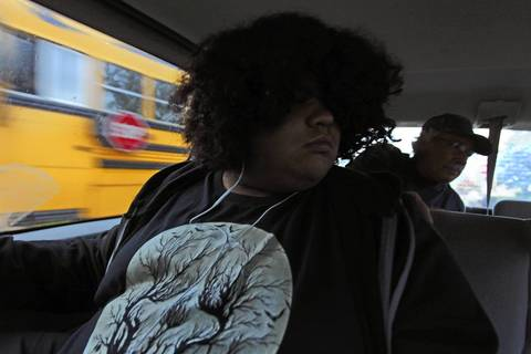 Alex Frausto, 12, and his family drive to a truancy hearing at the LaSalle County Criminal Justice Center in Ottawa.