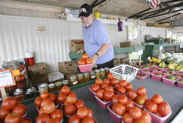 Chuck Allen operates a traveling produce stand at the Water Oak Country Club community in Lady Lake, Fl. on Tuesday, September 25, 2012. Allen and his wife, Gail, have taken their 30-foot trailer to retirement communities since 1997. And its all Florida produce -- tomatoes, watermelon, cantaloupe, cabbage, bananas, lettuce . (Tom Benitez/Orlando Sentinel)