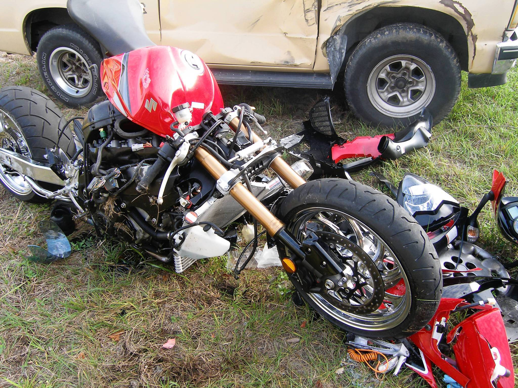 Anthony Thomason's Suzuki: The front wheel and fork were not damaged -- evidence, one expert said, that he was popping a wheelie when he crashed. (Florida Highway Patrol)