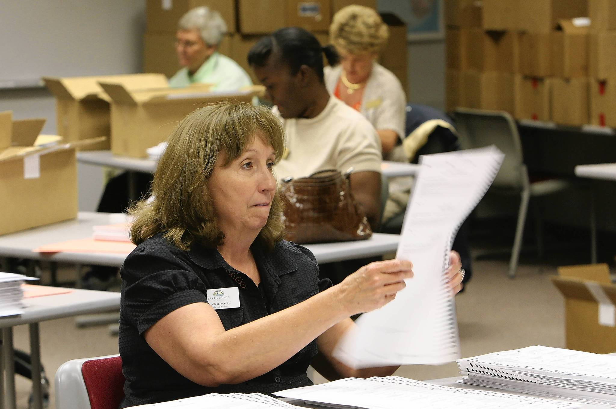 Carol Boyle separates ballots to be re-counted on Tuesday, November 13, 2012, in Tavares, Fl. Lake County officials started a mandatory recount this morning,  of the Mount Dora City Council District 3 race, with Ed Rowlett holding a one-vote lead over incumbent Jim Yatsuk, and the Lake County School Board District 2 race between chairwoman Rosanne Brandeburg and member Jim Miller.  (Tom Benitez/Orlando Sentinel)