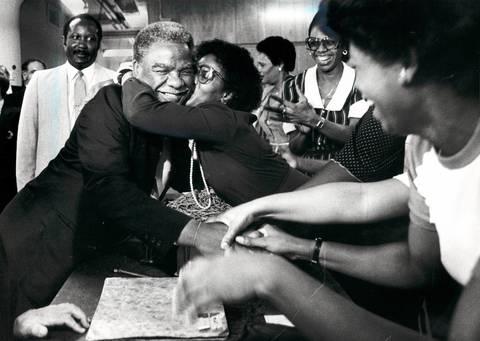 Mayor Harold Washington gets a warm reception from Spiegel employees during a tour of the mail-order operation at 1040 W. 35th St. The company said it plans to stay in Chicago and renovate its plant, which employs 2,000 people.