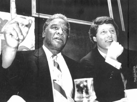 Chicago's Mayor Harold Washington talks with Arkansas Governor Bill Clinton before the start of a fundraising dinner in Little Rock. Earlier Washington agreed to cancel two other appearances including a reception at the governor's mansion because of the objections of local black leaders.