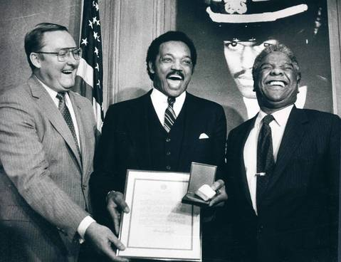 Gov. Jim Thompson, left, Jesse Jackson, center, and Mayor Harold Washington laugh during a ceremony where Mayor Washington presented a Chicago Medal of Merit to Jackson.