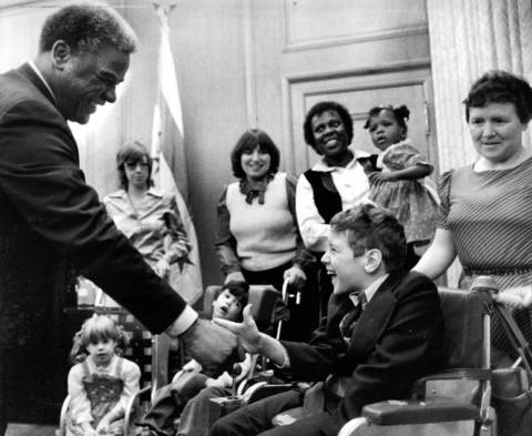 "Mayor Harold Washington meets 10-year-old Brendan McNamee in City Hall during a gathering of the Easter Seal Society of Metropolitan Chicago's ""Poster People."""