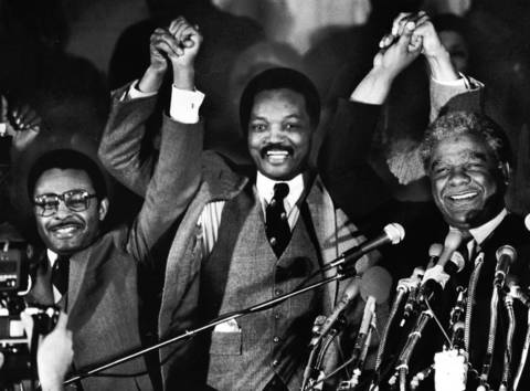 Presidential candidate Jesse Jackson, center, U.S. Senatorial hopeful Roland Burris, left, and Chicago Mayor Harold Washington stand together at a rally.
