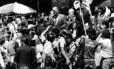 """Members of news media crowd around Mayor Washington as he addresses a gathering at Daley Center Plaza. Said one out-of-town correspondent, """"There's probably not another city in the country whose local politics get as much national attention as Chicago."""""""