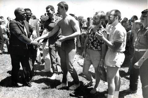 Mayor Harold Washington meets those attending a gay rights rally in Lincoln Park. Washington promised to sign an ordinance prohibiting discrimination against homosexuals if it is approved by the Chicago City Council. He said the fight for gay rights is part of the larger struggle for civil rights.