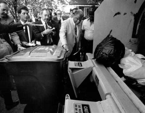 """""""It's an innovative idea,"""" said Mayor Harold Washington, inspecting the new garbage system instituted in the 8th Ward. The system is designed to use three-man crews and plastic carts."""