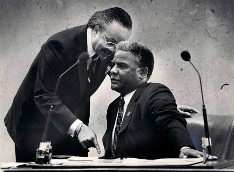 Ald. Clifford P. Kelley, left, confers with Mayor Harold Washington during a City Council meeting.