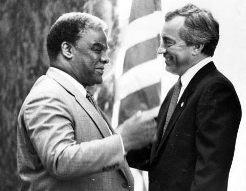 Chicago Mayor Harold Washington and Ald. Edward Vrdolyak (10th) have a rare, friendly conversation after a special City Council session.