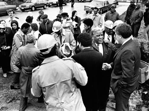 Mayor Harold Washington shakes hands at the groundbreaking ceremony for townhouses at 46th Street and Woodlawn Avenue. It was his last public appearance before his heart attack later that day.