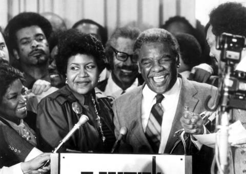 Harold Washington, accompanied by his fiancee Mary Ella Smith, left, celebrates winning the Democratic nomination for the mayor of Chicago. Washington upset Mayor Byrne and up-and-comer Richard M. Daley.