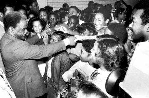 Democratic mayoral candidate Harold Washington shakes hands with students at DuSable High School in 1983. Washington graduated from the school in 1942.