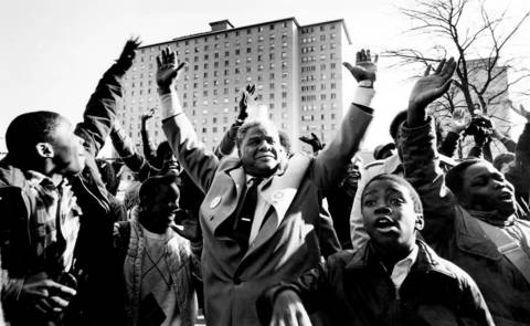 Mayor Harold Washington is joined by an enthusiastic crowd during a visit to the Robert Taylor Homes in 1987.