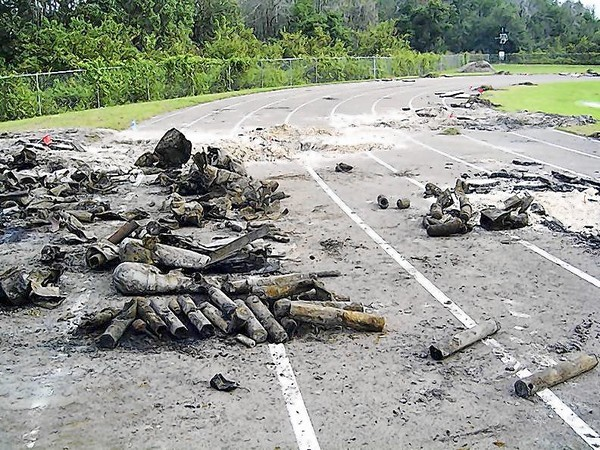 Bombs and debris found by the Army Corps of Engineers at Odyssey Middle School during school break are piled on the track at the school in 2008. (Courtesy of Army Corps of Engineers)