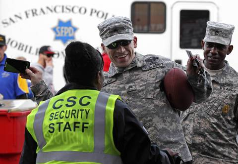 A U.S. Army sergeant goes through a security check at Candlestick Park.